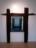1967 La porte vers l'au-delà, oeuvre tactiliste sur bois, encadrée de planches calcinées, exposée au Musée de Innsbrück en 1967